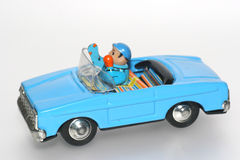 Tin toy car with driver. One of the many thousand  toys my brother is collecting. Tin toy car with driver Royalty Free Stock Photography