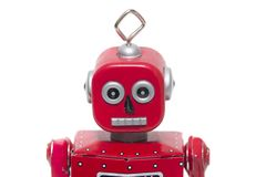 Tin toy robot. Vintage retro red tin toy robot isolated on a white background royalty free stock photography