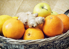 Tin wicker basket with apples, oranges and ginger, closeup Stock Photography
