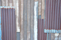 Tin and wood wall. The texture of tin and wood wall stock images
