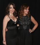 Tina Fay, Amy Poehler. NEW YORK-DEC 8: Actresses Tina Fay (L) and Amy Poehler attends the premiere of Sisters at the Ziegfeld Theatre on December 8, 2015 in New Royalty Free Stock Photo