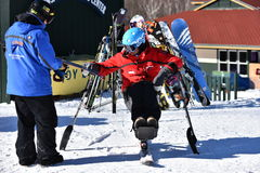 Tina Sutton Memorial - Slalom Ski Competition. Unidentified disabled skier attend to junior ski race Stock Image