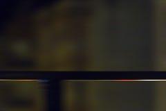 Tinad räcke på natten Arkivbilder