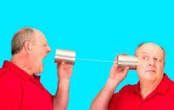 Tincanen stränger telekommunikationar fotografering för bildbyråer