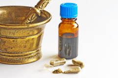 Tincture and pills Stock Photos