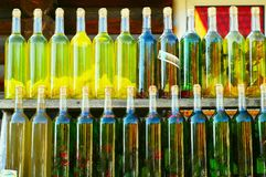 Tinctures, home-made drinks in glass vintage bottles on a wooden background, concept of authentic objects royalty free stock photos