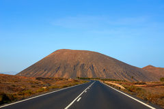 Tindaya road with mountain Fuerteventura Stock Photos