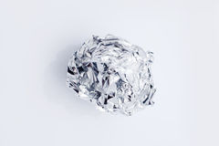 Tinfoil Ball Isolated on White. Damaged aluminium foil Royalty Free Stock Image