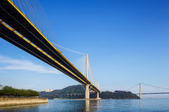 Ting Kau and Tsing Ma suspension bridge in Hong Kong. With clear blue sky Royalty Free Stock Photos