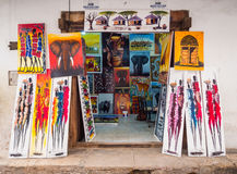 Tingatinga (tinga tinga) paintings in Stone Town, Zanzibar, Tanzania. Local store selling colorful tingatinga (tinga tinga) paintings as souvenirs for tourists stock photos
