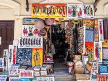 Tingatinga (tinga tinga) paintings in Stone Town, Zanzibar, Tanzania. Local store selling colorful tingatinga (tinga tinga) paintings of Masaai warriors and Stock Photos