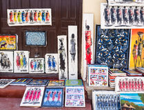 Tingatinga (tinga tinga) paintings in Stone Town, Zanzibar, Tanzania. Local store selling colorful tingatinga (tinga tinga) paintings of Masaai warriors and Royalty Free Stock Images