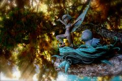 Tinker bell Fairy Statue at Disneyland. Green patina bronze statue of Tinker Bell in Disneyland is tucked away in a hidden grotto near the base of the Cinderella Royalty Free Stock Images