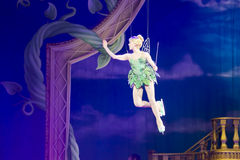 Tinker Bell Leaves. GREEN BAY, WI - MARCH 10:  Tinker Bell from Peter Pan on skates leaves on wires at the Disney on Ice Treasure Trove show at the Resch Center Royalty Free Stock Image