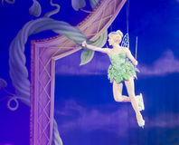 Tinker Bell waving to crowd. GREEN BAY, WI - MARCH 10: Tinker Bell from Peter Pan flies high above the ice the Disney on Ice Treasure Trove show at the Resch Royalty Free Stock Photography