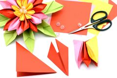 Tinker a colorful paper water lily. origami on white isolated ba Stock Photo