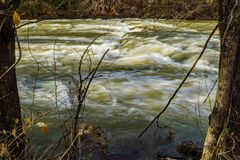 Tinker Creek at Flood Stage. Roanoke, Virginia – December 16th: A view of the Tinker Creek at flood stage after a winter snow melt located in Mason Mill stock image