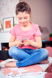 Tinker gifts. A teenage girl tinker gifts at home Stock Image