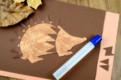 Tinker a hedgehog with paper and scissors Royalty Free Stock Photography