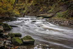 Tinker`s Creek. Beautiful autumn scene of the winding rapids of Tinker`s Creek in Cleveland Ohio royalty free stock image