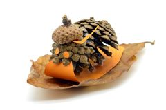 Tinker small snail figure made of pine cone and acorn parts with. Paper Royalty Free Stock Images