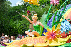 Tinkerbell waving wand. ORLANDO - MAY 2014: Tinkerbell waving wand from the Festival of Fantasy Parade at the Magic Kingdom, Walt Disney World. Picture taken Stock Photo