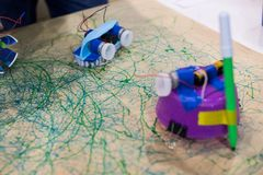Tinkering trash toys activities. STEAM activity for classroom. B. Rush with motors, felt-tip pens and batteries, game for children to discover electricity and stock photos