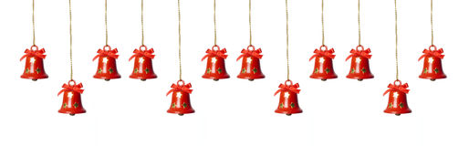 Tinkle bells. Hanging in a row isolated in white royalty free stock photo