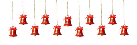 Tinkle bells. Hanging in a row isolated in white Stock Photography