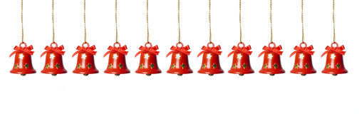 Tinkle bells hanging in a row. Isolated in white royalty free stock photo