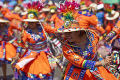 Tinku Dance Group - Arica, Chile. Tinku dancing group in colourful costumes performing a traditional ritual dance as part of the Carnaval Andino con la Fuerza royalty free stock photo