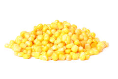 Tinned corn. The tinned corn lies a beautiful pyramid on a white background Stock Image