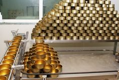 Tinned food factory. Conveyor and stack of empty cans on the tinned food factory stock photos