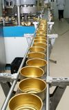 Tinned food factory. Conveyor with empty cans on the tinned food factory royalty free stock image
