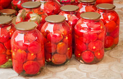 Tinned tomatoes in big glass jars. Royalty Free Stock Photo