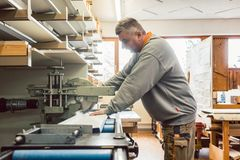 Tinner working on metal sheets in his workshop stock photo