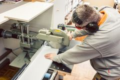 Tinner working on metal sheets in his workshop royalty free stock images