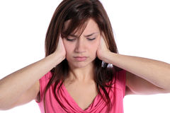 Tinnitus. An attractive young woman suffering from tinnitus. All on white background Royalty Free Stock Image