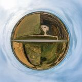 Tinny planet panorama of a never-ending road