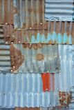 Tinplate full of patch patterns. Patchwork of tinplates full of spliced patches Royalty Free Stock Image