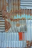 Tinplate full of patch patterns. Patchwork of tinplates full of spliced patches Stock Photos