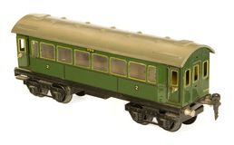 Tinplate german toy 1930s railroad carriage, green. Tinplate german 1930s toy railroad carriage by Marklin Royalty Free Stock Images