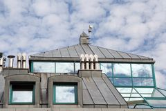 Tinplate roof and windows. Metal roof and reflecting windows Royalty Free Stock Images