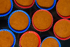 Tins with dough for cakes. Few blue and red tins with dough for chocolate cakes royalty free stock photos