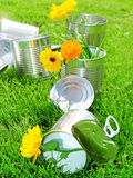 Tins in grass. Recycling concept stock photo