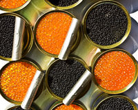 Tins with red and black caviar Stock Photo
