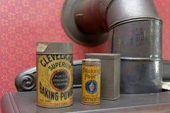 Tins on Stove Stock Photography