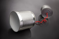 Tins telephones. On grey background royalty free stock images