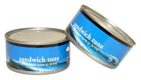 Tins Of Tuna Fish. Two unopened tins of tuna fish in brine, isolated on a white background stock photo