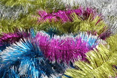 Tinsel. Pink, yellow, blue and white Christmas tinsel Royalty Free Stock Images